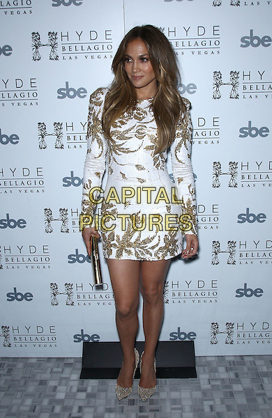 "Jennifer Lopez.Jennifer Lopez celebrates the release of new single ""Goin' In"" at Hyde Bellagio inside the Bellagio Resort & Casino, Las Vegas, Nevada,USA, .26th May 2012..full length white sparkly glittery clutch bag mini dress long sleeve gold  shoes christian louboutin sequined sequin .CAP/ADM/MJT.© MJT/AdMedia/Capital Pictures."