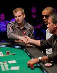 Team Pokerstars Pro Greg DeBora gets a handshake from Dan Shak after being eliminated.