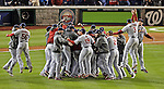 12 October 2012: The St. Louis Cardinals celebrate winning Postseason Playoff Game 5 of the National League Divisional Series against the Washington Nationals at Nationals Park in Washington, DC. The Cardinals stunned the home team Nats with a four-run rally in the 9th inning to defeat the Nationals 9-7 and win the NLDS, moving on to the NL Championship Series. Mandatory Credit: Ed Wolfstein Photo