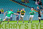 Limerick duo Padraig Horan and Eddie Mulcahy fail to stop the advance of Gary Sayers in the Munster Junior Championship Semi final held in the Gaelic Grounds last Saturday.