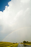 Rainbow after clearing late afternoon thunder and hail over US 20 near the Sand Hills town of Merriman, Nebraska.