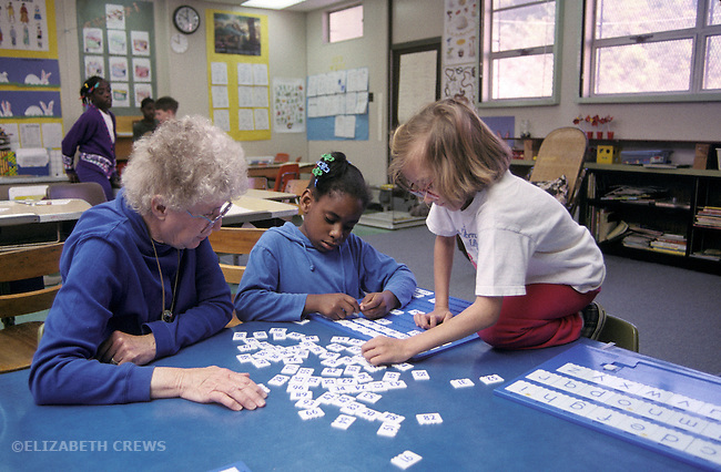 Oakland, CA Students around second grade working on identifying numbers and letters in class for the learning handicapped