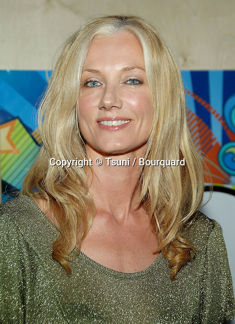 Joely Richardson arriving at the tca ( television critic association )  FOX Summer party on the Santa Monica Pier in Los Angeles.<br /> <br /> headshot<br /> eye contact<br /> smile<br /> green dress