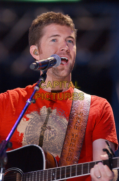 JOSH TURNER.2007 CMA Music Festival held at LP Field, Nashville, Tennessee, USA..June 9th, 2007.half length stage concert live music gig performance stubble facial hair singing microphone.CAP/ADM/GS.©George Shepherd/AdMedia/Capital Pictures