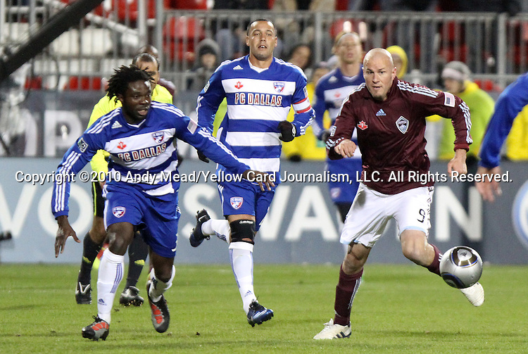 21 November 2010: Colorado's Conor Casey (9) and Dallas' Ugo Ihemelu (left) chase the ball followed by Daniel Hernandez (behind). The Colorado Rapids defeated FC Dallas 2-1 in overtime at BMO Field in Toronto, Ontario, Canada in MLS Cup 2010, Major League Soccer's championship game.