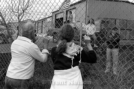 War protesters and pro-war people yell at each other through a fence at Gulf War protest at the Concord Naval Weapons Station.<br />