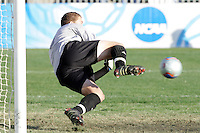 Maryland goalkeeper Chris Seitz makes a save on a penalty kick taken by New Mexico's Andrew Boyens (not pictured). The save preserved Maryland's 1-0 margin of victory. The University of Maryland defeated the University of New Mexico 1-0 in the NCAA Final at SAS Stadium in Cary, North Carolina, Sunday, December 11, 2005.