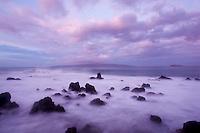 Misty water and lava rocks at Makena,Maui.