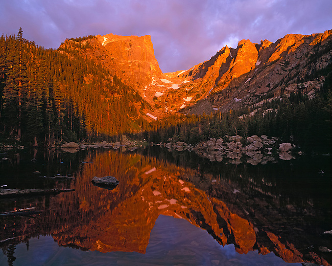 A summer sunrise on Hallett Peak, reflecting in Dream Lake, in Rocky Mountain National Park, CO