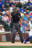 Umpire Mark Carlson makes a call during a game between the Milwaukee Brewers and Chicago Cubs on August 13, 2015 at Wrigley Field in Chicago, Illinois.  Chicago defeated Milwaukee 9-2.  (Mike Janes/Four Seam Images)