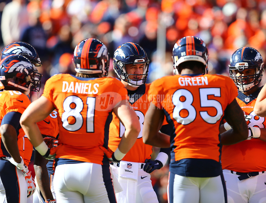 Jan 24, 2016; Denver, CO, USA; Denver Broncos quarterback Peyton Manning (center) in the huddle with teammates against the New England Patriots in the AFC Championship football game at Sports Authority Field at Mile High. The Broncos defeated the Patriots 20-18 to advance to the Super Bowl. Mandatory Credit: Mark J. Rebilas-USA TODAY Sports