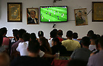 Palestinians watch on a screen the Russia 2018 World Cup final football match between France and Croatia, in the West Bank city of Nablus on July 15, 2018. Photo by Shadi Jarar'ah