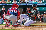 10 March 2015: Miami Marlins infielder Jordany Valdespin is tagged sliding home by Washington Nationals catcher Dan Butler during Spring Training action at Roger Dean Stadium in Jupiter, Florida. The Marlins edged out the Nationals 2-1 on a walk-off solo home run in the 9th inning of Grapefruit League play. Mandatory Credit: Ed Wolfstein Photo *** RAW (NEF) Image File Available ***