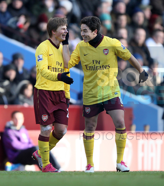 Arsenals Andrey Arshavin celebrates his opening goal with Samir Nasri