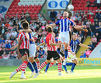 Lincoln City's John Akinde vies for possession with Sheffield Wednesday's Tom Lees<br /> <br /> Photographer Chris Vaughan/CameraSport<br /> <br /> Football Pre-Season Friendly - Lincoln City v Sheffield Wednesday - Friday 13th July 2018 - Sincil Bank - Lincoln<br /> <br /> World Copyright &copy; 2018 CameraSport. All rights reserved. 43 Linden Ave. Countesthorpe. Leicester. England. LE8 5PG - Tel: +44 (0) 116 277 4147 - admin@camerasport.com - www.camerasport.com