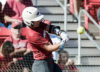 NWA Democrat-Gazette/CHARLIE KAIJO Arkansas Razorbacks catcher Taylor Greene (11) contacts the ball during a softball match, Sunday, October 28, 2018 at Bogle Park, University of Arkansas in Fayetteville.<br />