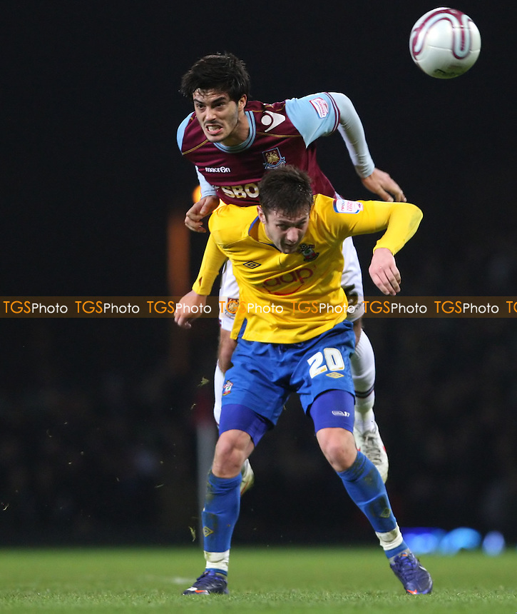 James Tomkins of West Ham and Adam Lallana of Southampton - West Ham United vs Southampton, npower Championship at Upton Park, West Ham - 14/02/12 - MANDATORY CREDIT: Rob Newell/TGSPHOTO - Self billing applies where appropriate - 0845 094 6026 - contact@tgsphoto.co.uk - NO UNPAID USE..