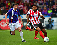 Lincoln City's Matt Green vies for possession with Exeter City's Pierce Sweeney<br /> <br /> Photographer Andrew Vaughan/CameraSport<br /> <br /> The EFL Sky Bet League Two Play Off First Leg - Lincoln City v Exeter City - Saturday 12th May 2018 - Sincil Bank - Lincoln<br /> <br /> World Copyright &copy; 2018 CameraSport. All rights reserved. 43 Linden Ave. Countesthorpe. Leicester. England. LE8 5PG - Tel: +44 (0) 116 277 4147 - admin@camerasport.com - www.camerasport.com