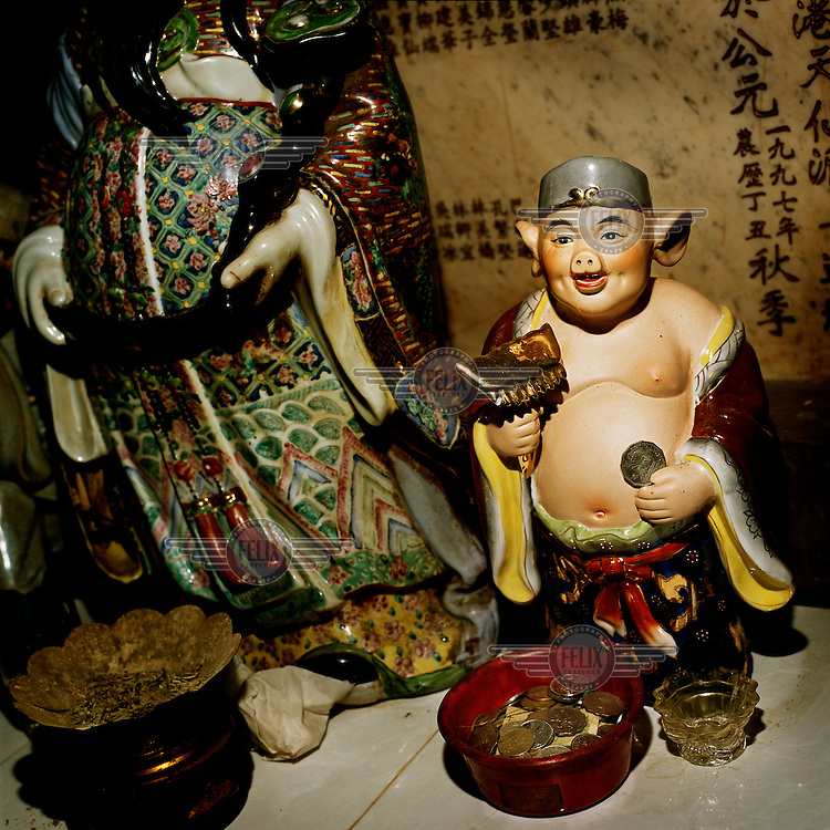 Figurines in a Cantonese temple where the pig is seen as a symbol of luck.