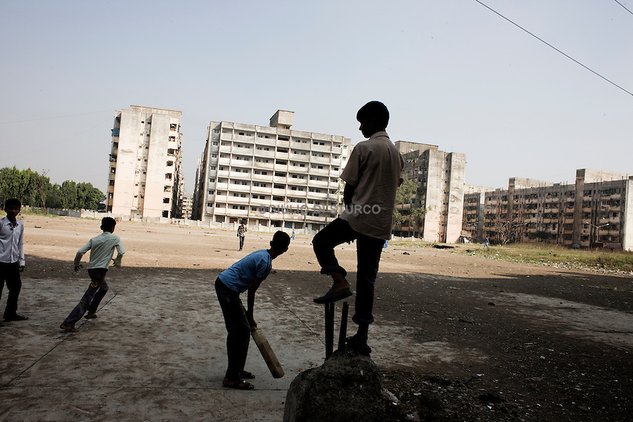 Childre play Cricket In front of the bulding number 69 one of the most populated building in Lallubhai,18 November 2010.