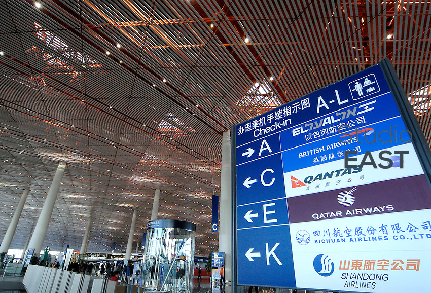 A sign indicates the location of El Al airline, British airways, Qantas airline, Qatar airways, Sichuan airlines, and Shandong airlines, the six airlines that begin flying today to the new Terminal 3 building at Beijing Airport in Beijing, China, on February 29, 2008. The terminal, which opens today, is a centerpiece project for the 2008 Olympics and is designed to relieve the overloaded airport's other two terminals and accommodate expected rapid growth in the number of visitors to Beijing. The huge, airy terminal will have 64 Western and Chinese restaurants, 84 retail shops, and a state-of-the-art-baggage handling system. Photo by Simon Lim/Pictobank