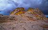 A storm passes through the colorful rock formations of White Pocket at the Vermillion Cliff National Monument, Arizona