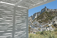 Barely discernable at first but a number of houses have been built into the sheer rock face of the mountain side seen here from the covered terrace