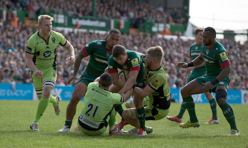 Leicester Tigers' Ben Youngs is tackled by Northampton Saints' Kahn Fotuali'i and James Craig<br /> <br /> Photographer Stephen White/CameraSport<br /> <br /> Rugby Union - Aviva Premiership - Leicester Tigers v Northampton Saints - Saturday 16th May 2015 - Welford Road - Leicester<br /> <br /> &copy; CameraSport - 43 Linden Ave. Countesthorpe. Leicester. England. LE8 5PG - Tel: +44 (0) 116 277 4147 - admin@camerasport.com - www.camerasport.com