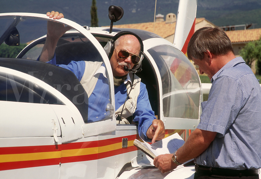 Retired man planning his flight in his private light plane