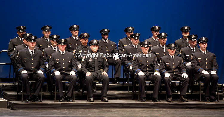 WATERBURY, CT-020614JS07- 19 officers  from the Waterbury Police Academy Class 2013-1 graduated and were received their badges during graduation ceremonies Thursday at the Palace Theater in Waterbury. <br /> Jim Shannon Republican-American