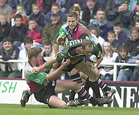 14/04/2002.Sport - Rugby Union.Madjeski Stadium - Reading.Zurich Premiership.London Irish vs Harlequins.Quins Matt Powell Left and Rob Jewell hang onto Exiles coach and centre Brendan Venter,...