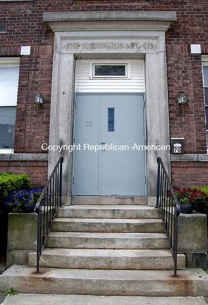 TORRINGTON, CT, 05  JUNE 15 - The doorway to 70 Franklin Street, which used to lead into a drug den, has fresh paint and is flaked by potted petunias.    Alec Johnson/ Republican-American