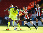 Tom Huddlestone of Derby County tackled by John Lundstram of Sheffield Utd  during the Championship match at Bramall Lane, Sheffield. Picture date 26th August 2017. Picture credit should read: Simon Bellis/Sportimage