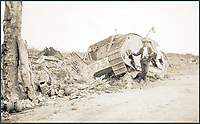 BNPS.co.uk (01202 558833)<br /> Pic: Pen&amp;Sword/BNPS<br /> <br /> Ivan is very casually standing next to the wreck of tank D32, named &lsquo;Dop Doctor&rsquo;.<br /> <br /> A poignant collection of images which were taken by a photographer who documented the graves of fallen soldiers on the Western Front have come to light in a new book.<br /> <br /> Ivan Bawtree was one of only three professional photographers assigned to the the Graves Registration Units to photograph and record the graves of fallen First World War soldiers on behalf of grieving relatives. <br /> <br /> His powerful photos of northern France and Flanders are a haunting reminder of the horrors of war and a fascinating insight into the early work of the Imperial War Graves Commission. <br /> <br /> Prior to the First World War, the casualties of war were generally buried in unmarked mass graves.