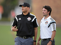 Oct 29, 2014; Orange, CA, USA; Occidental College Tigers coach Rod Lafaurie (left) and assistant coach Josh Ault against the Chapman College Panthers. Photo by Kirby Lee