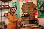 """A Palestinian artist Dima Sha'sha'a """"owner of Tezzkar Project"""" works at her shop in Gaza city on February 28, 2018. Dima and her brother Hamdi take the drawing on dishes, cardboard and glass as a job for nearly seven years. International Women's Day is annually held on March 8 to celebrate women's achievements throughout history and across nations. It is also known as the United Nations (UN) Day for Women's Rights and International Peace. Photo by Mahmoud Ajour"""