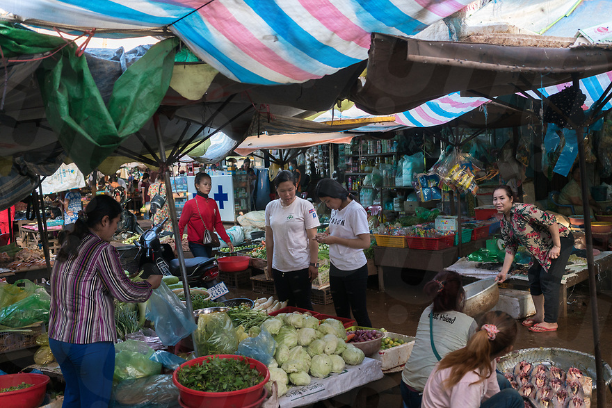 April 26, 2017 - Banlung (Cambodia). Team surveyors Thorn Chandoung and Thy Chantreahery visit the local market to buy food for dinner. The majority of the members of the team live and sleep inside NPA's headquarters, a former tourist resort with bungalows and communal areas located in the outskirts of Banlung. © Thomas Cristofoletti / Ruom