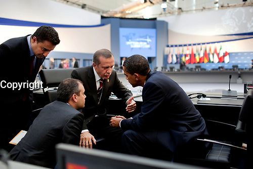 President Barack Obama talks with Turkish Prime Minister Recep Tayyip Erdogan following the G-20 Summit afternoon session in Pittsburgh, Pa., Sept. 25, 2009. (Official White House Photo by Pete Souza)<br /> <br /> This official White House photograph is being made available only for publication by news organizations and/or for personal use printing by the subject(s) of the photograph. The photograph may not be manipulated in any way and may not be used in commercial or political materials, advertisements, emails, products, promotions that in any way suggests approval or endorsement of the President, the First Family, or the White House.
