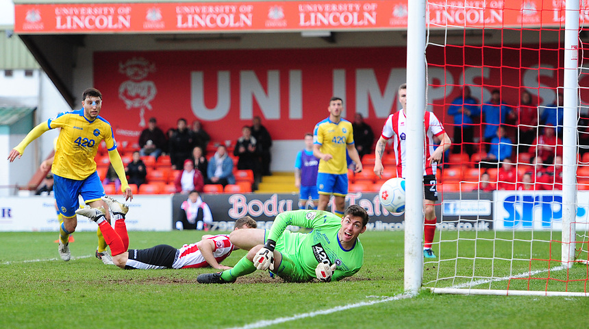 Torquay United's Brendan Moore watches as a header from Lincoln City's Adam Marriott bounces back off the post<br /> <br /> Photographer Chris Vaughan/CameraSport<br /> <br /> Vanarama National League - Lincoln City v Torquay United - Friday 14th April 2016  - Sincil Bank - Lincoln<br /> <br /> World Copyright &copy; 2017 CameraSport. All rights reserved. 43 Linden Ave. Countesthorpe. Leicester. England. LE8 5PG - Tel: +44 (0) 116 277 4147 - admin@camerasport.com - www.camerasport.com
