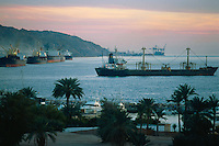 Jordan. Aqaba. Sunset. Aqaba is a holiday resort and a harbour on the Red Sea. Merchant vessels are anchored in the Gulf of Aqaba, which is divided between three countries: Jordan, Israel and Egypt. © 2002 Didier Ruef
