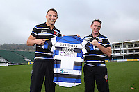 Bath Rugby's new signing Sam Burgess is presented with his shirt by Bath Head Coach Mike Ford during the media session. Bath Rugby Photocall on October 30, 2014 at the Recreation Ground in Bath, England.