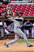 Clinton LumberKings outfielder Dimas Ojeda (14) swings at a pitch during a Midwest League game against the Wisconsin Timber Rattlers on April 26, 2018 at Fox Cities Stadium in Appleton, Wisconsin. Clinton defeated Wisconsin 7-3. (Brad Krause/Four Seam Images)