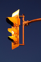 Traffic Signal with Amber Illuminated Against Clear Dusk Sky