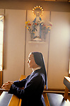 NUN PRAYING, KNOCK - S IRELAND,