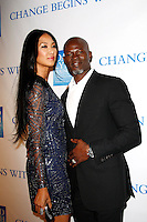 LOS ANGELES, CA - DEC 3: Kimora Lee; husband Djimon Hounsou at the 3rd Annual 'Change Begins Within' Benefit Celebration presented by The David Lynch Foundation held at LACMA on December 3, 2011 in Los Angeles, California
