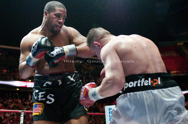 Newark, N.J, February 6th, 2010: Jason Estrada on the attack against  Tomasz Adamek (white trunk) during their IBF Heavyweight International Championship fight at the Prudential Center Arena. Adamek won by unanimous decision and retained his belt. Photo by Thierry Gourjon