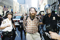 People get arrested as orotesters march toward Madison Square Garden during the United for Peace and Justice march in New York City on August 29, 2004.  The protest against the Bush administration in general (and its decision to hold the Republican National Convention in NYC) was one of the largest in the city's history, drawing an estimated  500,000 people.
