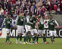 Portland Timbers midfielder Jack Jewsbury (13) celebrates his goal with teammates. In a Major League Soccer (MLS) match, the New England Revolution tied the Portland Timbers, 1-1, at Gillette Stadium on April 2, 2011.