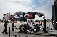 Apr. 26, 2013; Baytown, TX, USA: Crew members unload the car of NHRA funny car driver Cruz Pedregon during qualifying for the Spring Nationals at Royal Purple Raceway. Mandatory Credit: Mark J. Rebilas-