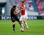 Nederland, Amsterdam, 13 september 2014<br /> Eredivisie<br /> Seizoen 2014-2015<br /> Ajax-Heracles<br /> Arkadiusz Milik (r.) van Ajax en Mark-Jan Fledderus van Heracles strijden om de bal.